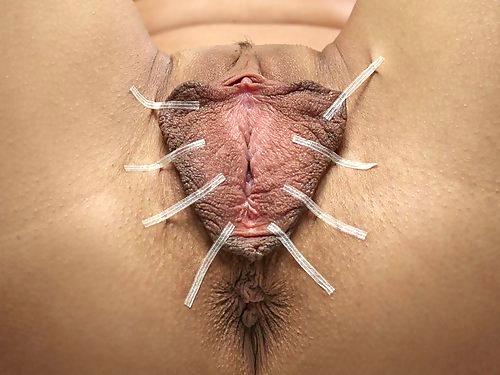 Tanned brunette tortures her huge pussy lips