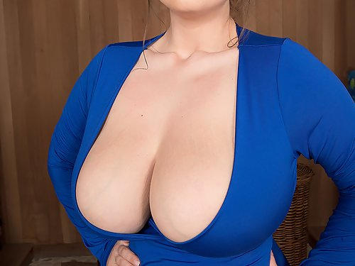 Chubby brunette shows off her huge saggy tits