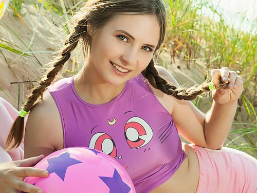 Busty brunette teen with pigtails stripping at the beach