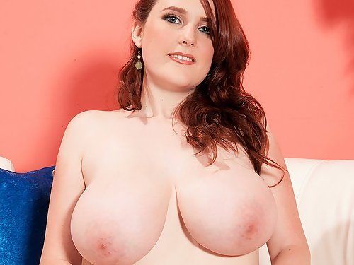 Chubby redhead with big tits stripping