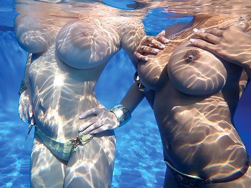 2 busty girls nude underwater