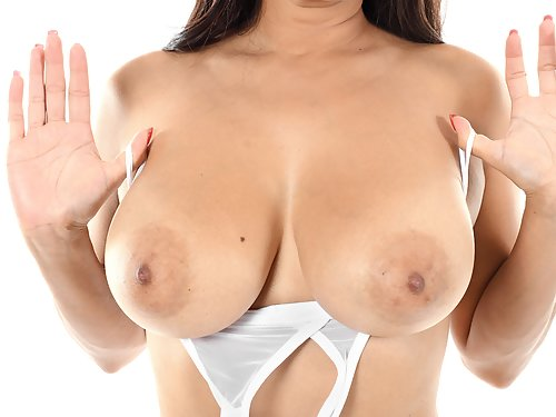 Busty Latina with big saucer nipples toying her shaved pussy