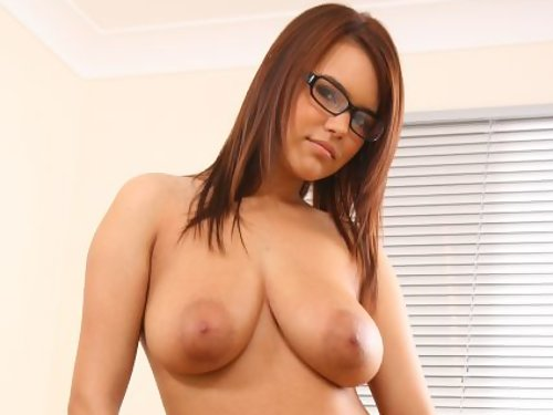 Nerdy secretary shows off her big boobs