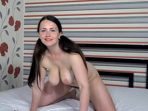 Busty brunette amateur plays with her hairy pussy