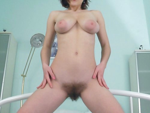 Redhead with large areolas toying her hairy pussy