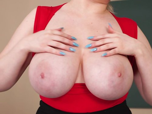 Chubby blonde shows off her huge boobs in class