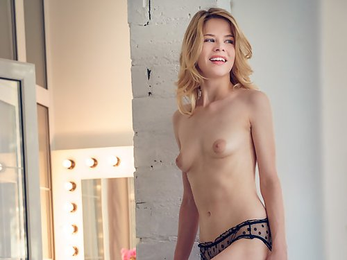 Blonde with large areolas takes off her see-through panties