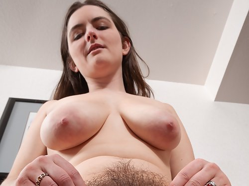 Chubby brunette amateur with big tits spreads her hairy asshole