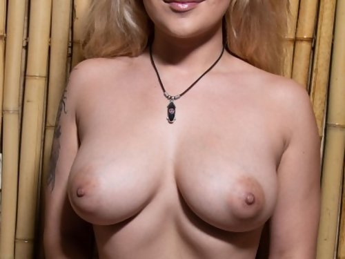 Chubby blonde with big tits spreading