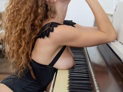 Freckled girl in silk lingerie