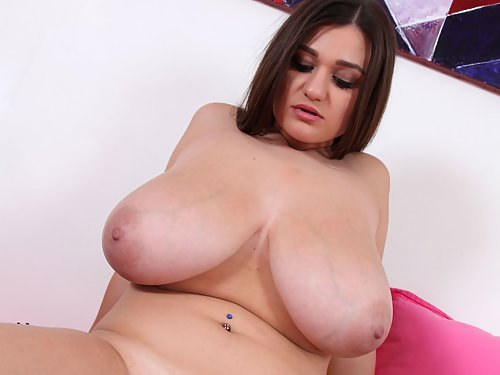 Chubby brunette with huge boobs stripping in bed