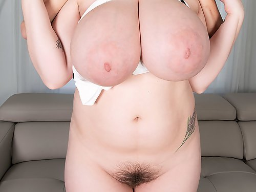 Hairy redhead with huge tits getting fucked