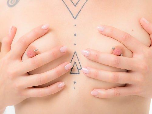 Tattooed blonde with big pierced nipples
