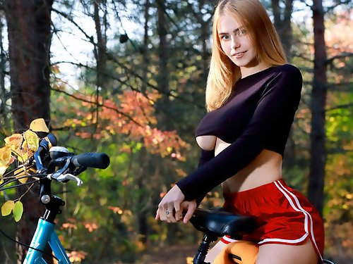 Blonde with large areolas nude on her bike