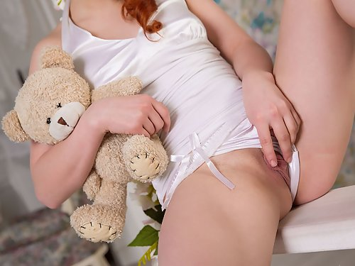 Cute redhead teen plays with her big pussy lips