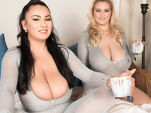 2 chubby girls with huge tits having fun in bed