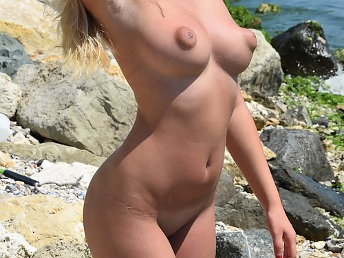 Tanned girl shows off her amazing puffy nipples