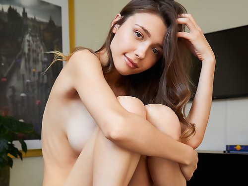 Busty brunette Mila Azul stripping