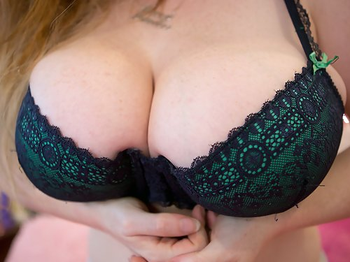 Curvy redhead amateur shows off her big freckled tits