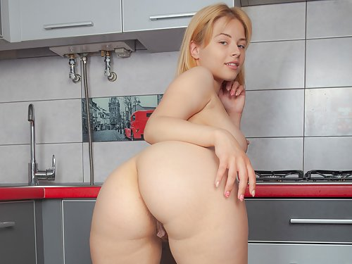 Chubby blonde with dangling pussy lips spreading in the kitchen
