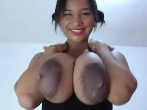 Busty Latina with huge lactating nipples