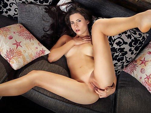 Sexy brunette fingering her meaty pussy