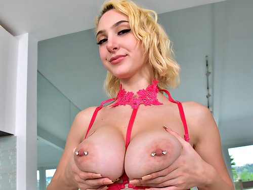 Busty blonde with large areolas in pink lingerie