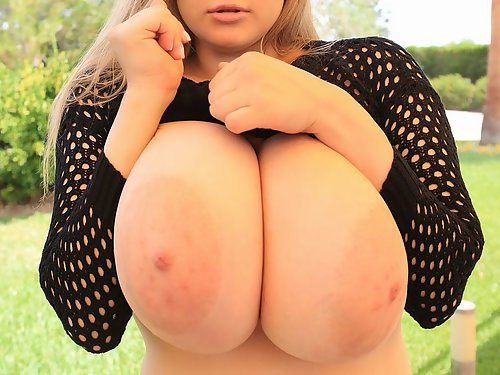 Chubby blonde shows off her enormous tits outdoors