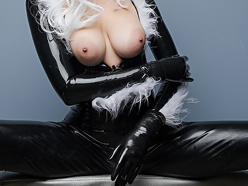 Busty cosplay babe in a latex costume