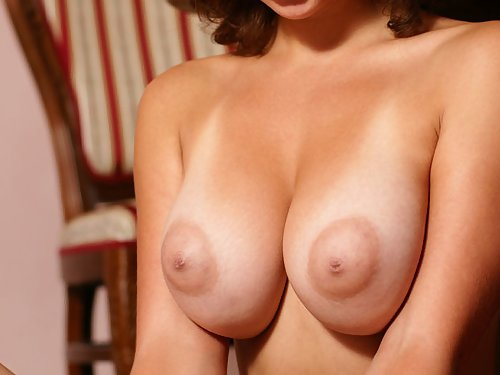 Brunette babe with tan lines and amazing big tits